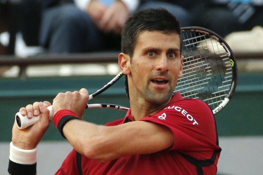 Serbia's Novak Djokovic returns in the third round match of the French Open tennis tournament against Britain's Aljaz Bedene at the Roland Garros stadium in Paris, France, Saturday, May 28, 2016. (AP Photo/Alastair Grant)