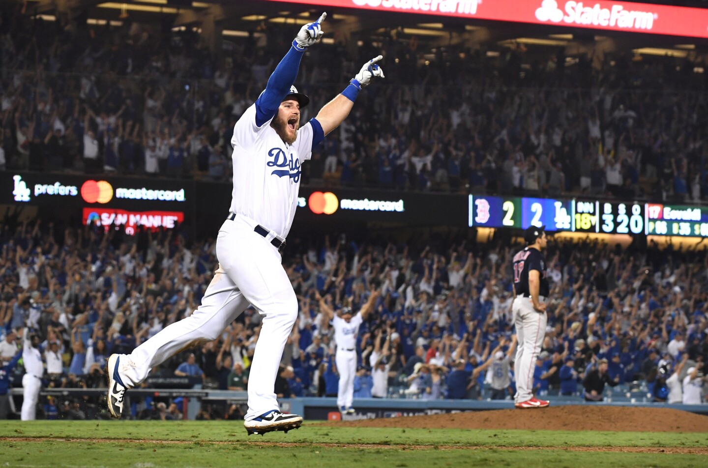 Dodgers Max Muncy hits the game-winning home run against the Red Sox in the bottom of the 18th inning.