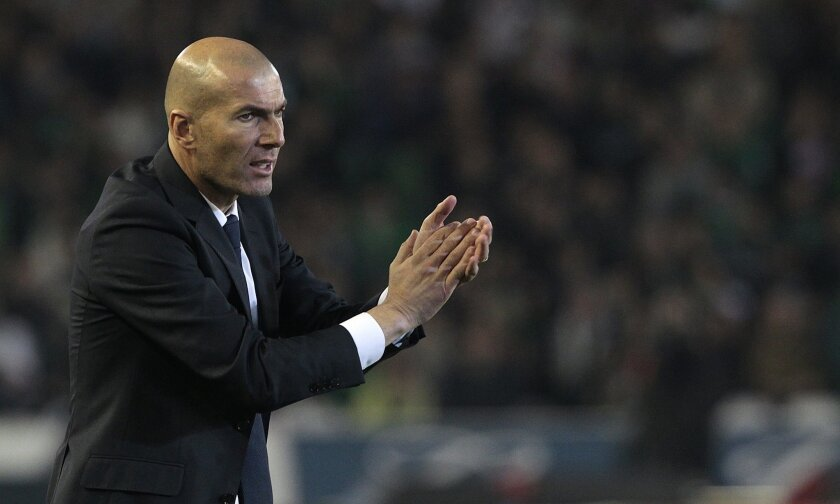 Real Madrid's coach Zinedine Zidane gestures during the La Liga soccer match between Real Betis and Real Madrid, at the Benito Villamarin stadium, in Seville, Spain, Sunday, Jan. 24, 2016. (AP Photo/Angel Fernandez)