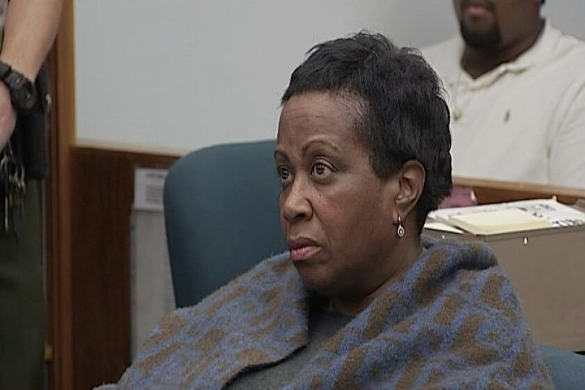 Carolyn Smith, former head of the Southeastern Economic Development Corp., listens in San Diego Superior Court as she is placed on probation for embezzlement and ordered to pay $435,018 in restitution to the city, along with a former co-worker.
