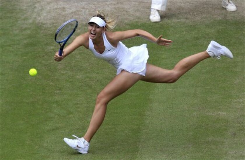 Russia's Maria Sharapova returns a shot during her semifinal match against Germany's Sabine Lisicki at the All England Lawn Tennis Championships at Wimbledon, Thursday, June 30, 2011. (AP Photo/Suzanne Plunkett, Pool)