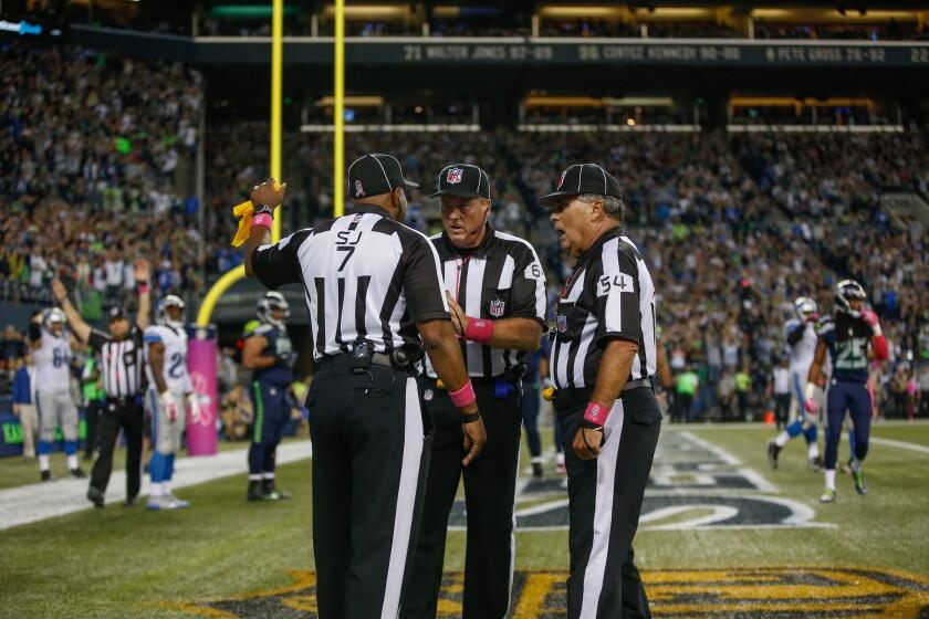Officials confer