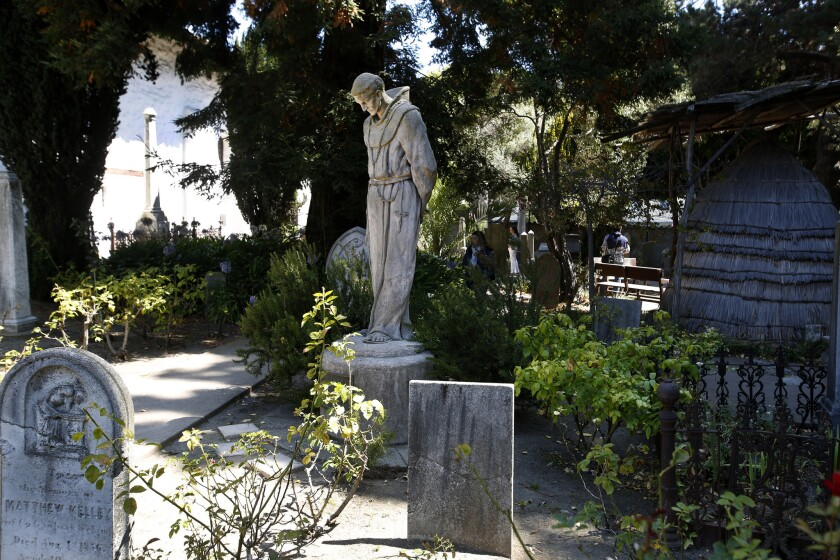 A statue of Junipero Serra in the graveyard at Mission San Francisco de Asis, often called Mission Dolores.