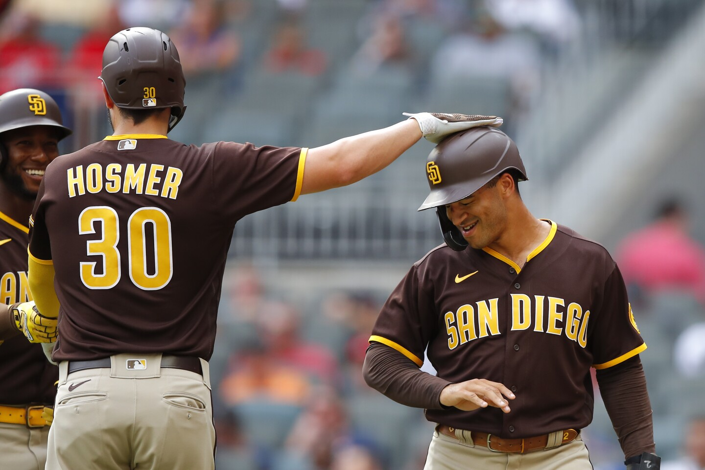 ATLANTA, GA - JULY 21: Trent Grisham #2 and Eric Hosmer #30 of the San Diego Padres celebrate after scoring in the first inning against the Atlanta Braves during game two of a doubleheader at Truist Park on July 21, 2021 in Atlanta, Georgia. (Photo by Todd Kirkland/Getty Images)