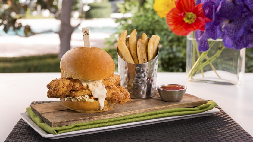 Crispy buttermilk sandwiches are on the poolside menu at Encore Beach Club. The food comes from Jardin, the resort's casual dining restaurant.