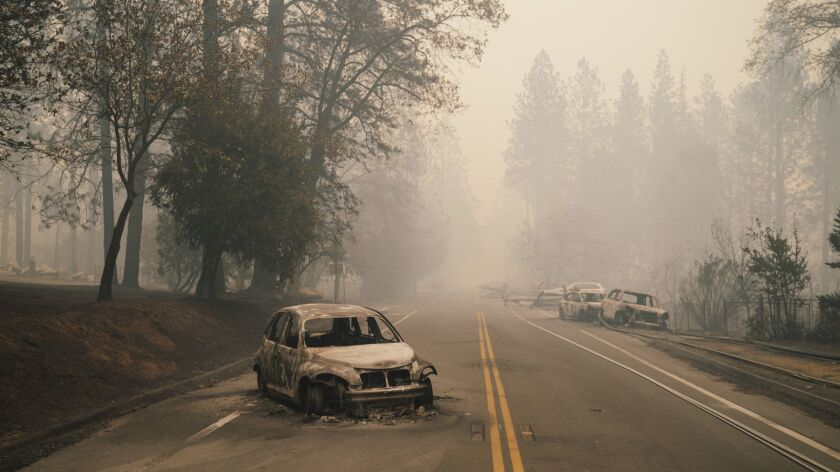 Vehicles abandoned on the road are seen in Paradise, Calif. Friday, Nov. 9, 2018. At least five peop
