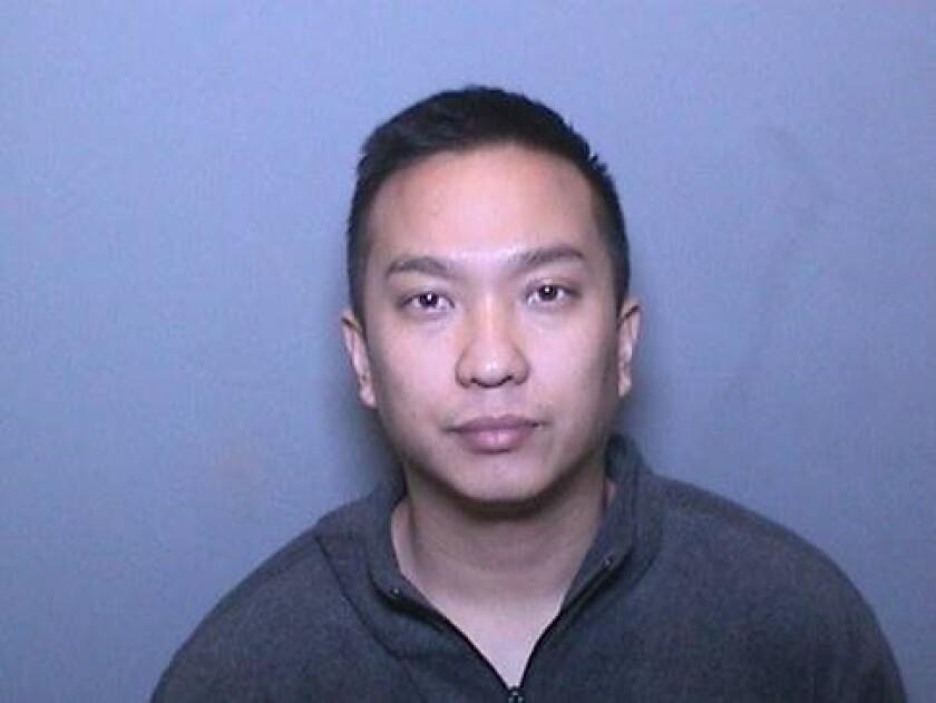 Mugshot of 29-year old Asian male wearing grey zip-up hoodie.