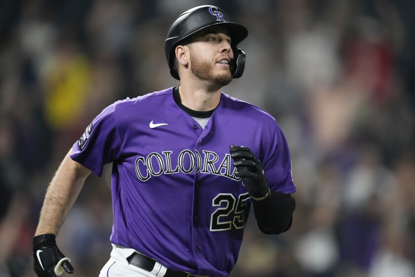 Colorado Rockies' C.J. Cron smiles as he circles the bases after hitting a walkoff solo home run off San Diego Padres relief pitcher Daniel Hudson in the ninth inning of a baseball game on Monday, Aug. 16, 2021, in Denver. (AP Photo/David Zalubowski)