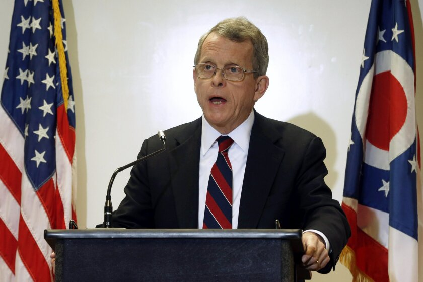 FILE - In this Nov. 25, 2013, file photo, Ohio Attorney General Mike DeWine announces indictments in an investigation of a 2012 rape of a high school student, during a news conference in Steubenville, Ohio. The 69-year-old Republican confirmed Thursday, May 26, 2016, that he plans to run for governor in 2018, after a Dayton Daily News reporter overheard DeWine sharing his less-than-secret plans with a Dayton, Ohio, charter school official. DeWine tells The Associated Press he is still not ready to make an official announcement, and is focused on supporting Republican candidates running this fall. (AP Photo/Keith Srakocic, File)