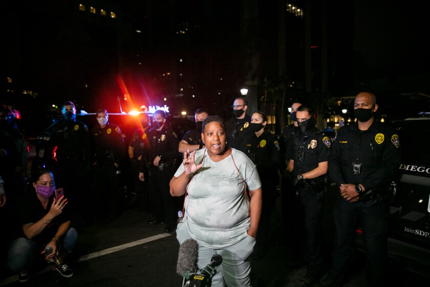 Activist Tasha Williamson speaks to the press and a crowd that had gathered on Sixth Avenue.