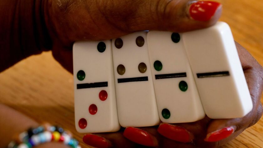 LOS ANGELES, CALIF. - FEB. 27, 2018. Player Bobbie Simmons holds her dominoes during the Skid Row do