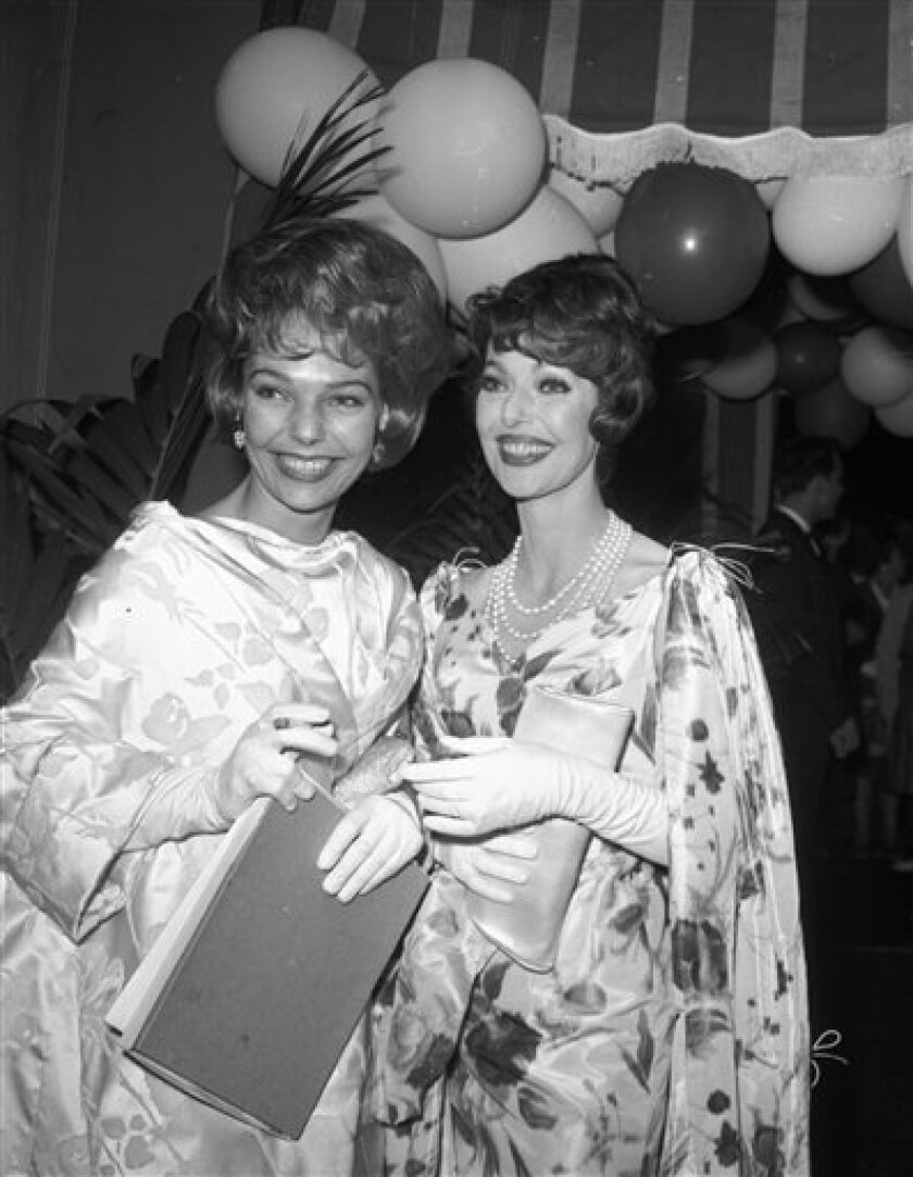 In this May 16, 1961 file photo, actress Loretta Young, right, and her daughter Judy Lewis attend a party following the Emmy awards in Hollywood.
