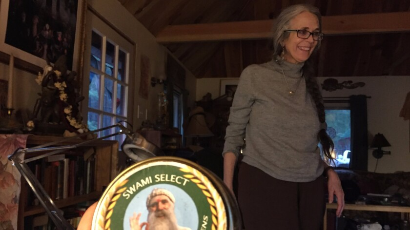 Nikki Lastreto, in background, with a distinctive Swami Select label in foreground