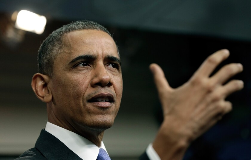 President Obama, shown at a White House briefing on the Affordable Care Act, cautioned Congress to avoid additional sanctions on Iran that could disrupt sensitive negotiations to rein in Tehran's nuclear program.