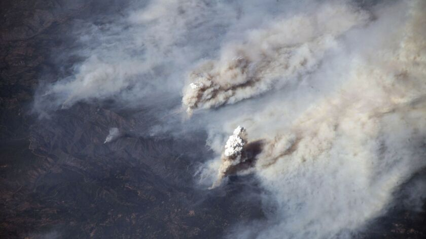 This Aug. 3, photo by European Space Agency astronaut Alexander Gerst aboard the International Space Station, provided by NASA, shows smoke from California's Carr and Ferguson fires blowing eastward across the western United States.