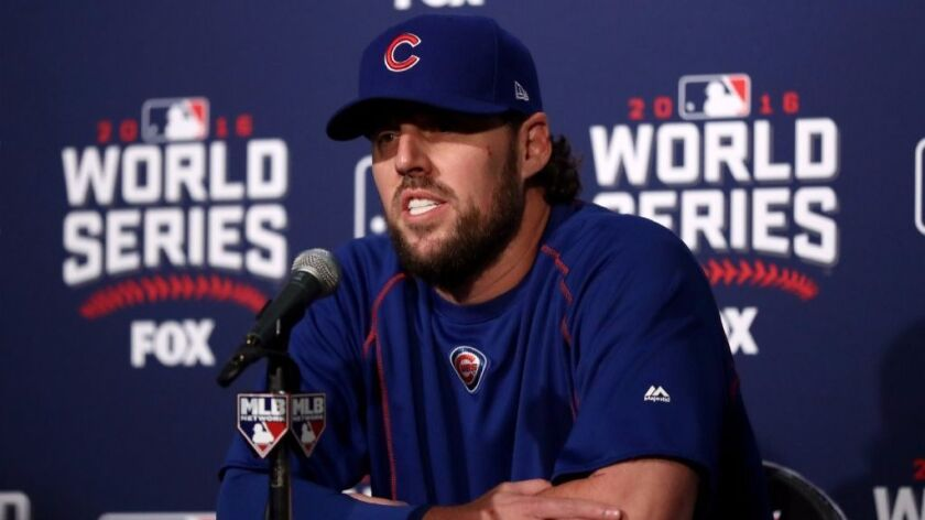 Cubs pitcher John Lackey, who has been in the big leagues for 14 years, fields media questions Friday before Game 3 of the World Series in Chicago.