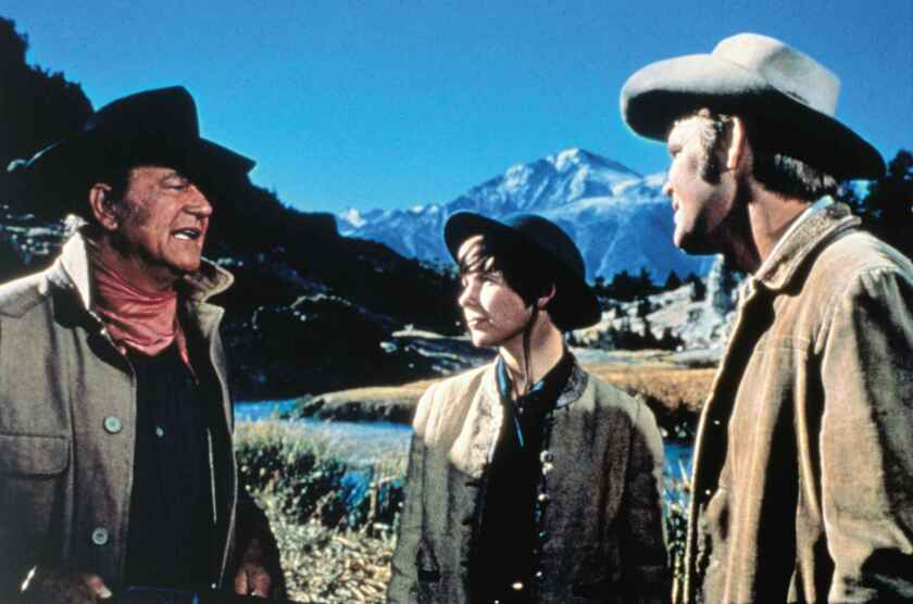 """John Wayne, left, Kim Darby and Glen Campbell in the 1969 movie """"True Grit,"""" based on the novel by Charles Portis."""