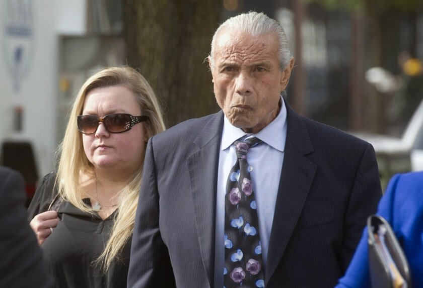 """FILE - In this Nov. 2, 2015, file photo, former professional wrestler Jimmy """"Superfly"""" Snuka, right, arrives for his formal arraignment at the Lehigh County Courthouse in Allentown, Pa. Following a four-day hearing, Lehigh County Judge Kelly Banach ruled from the bench Wednesday, June 1, 2016, that"""