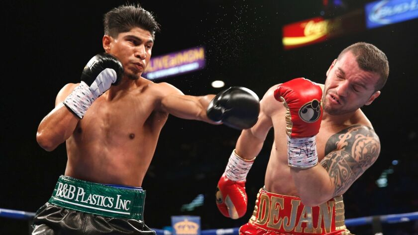 Mikey Garcia, left, connects on Dejan Zlaticanin during their WBC lightweight title fight on Jan. 28 in Las Vegas.