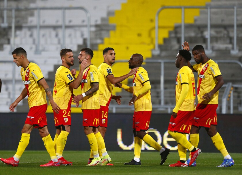 during the French League One soccer match between Lens and Reims at the Bollaert stadium in Lens, northern France, Friday, Oct. 1, 2021. (AP Photo/Michel Spingler)