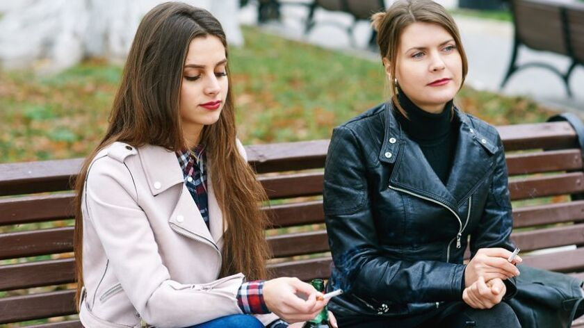 girls smoke in the city .Bad habits of people