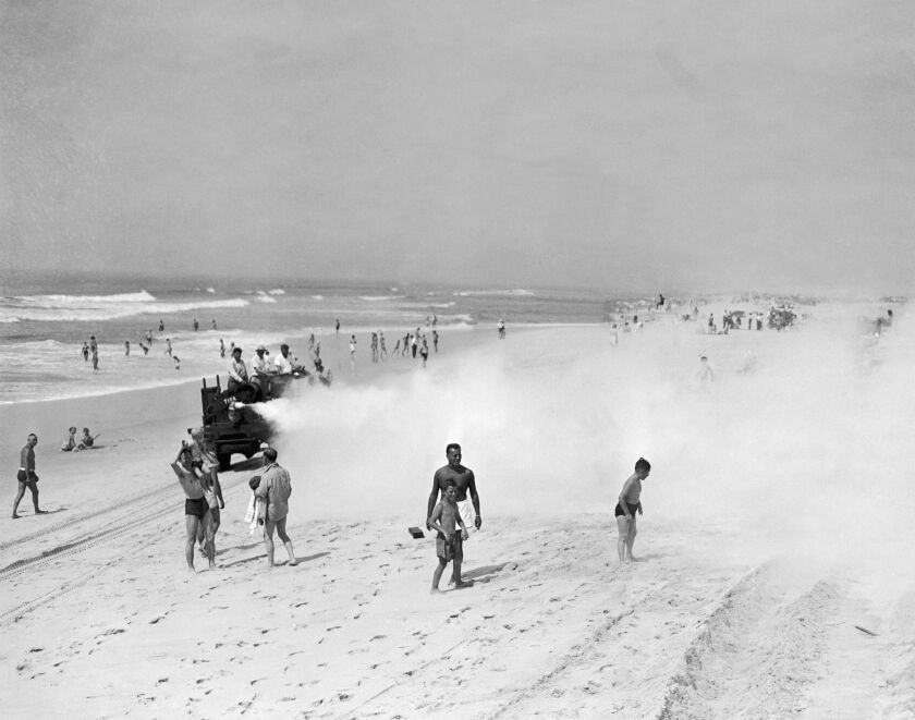 A truck sprays DDT in 1945 to eliminate mosquitoes on Jones Beach on Long Island.