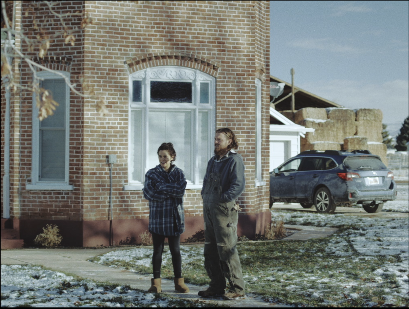 Niki (played by Sepideh Moafi) and David (Clayne Crawford) stand on a driveway