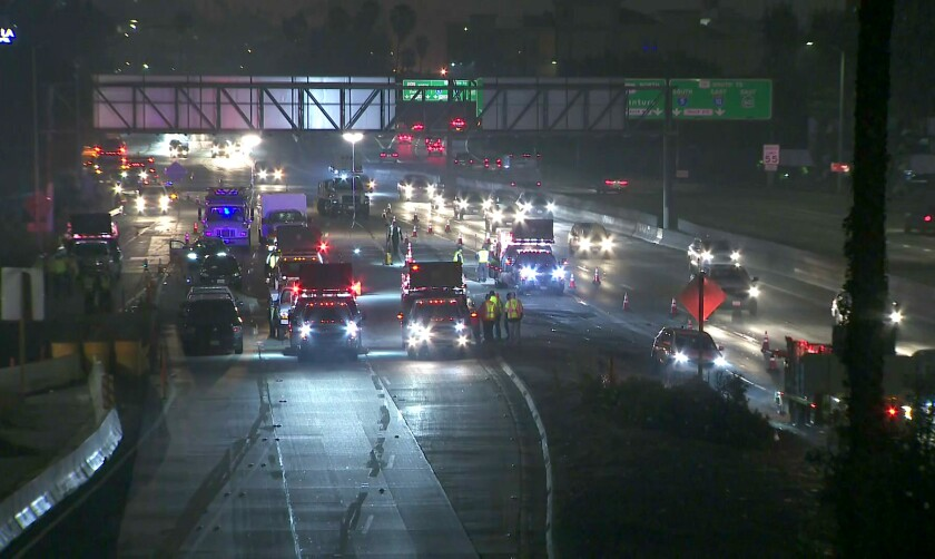 Traffic is stopped on the 110 Freeway after a Caltrans contract worker was struck and killed by a vehicle Wednesday.