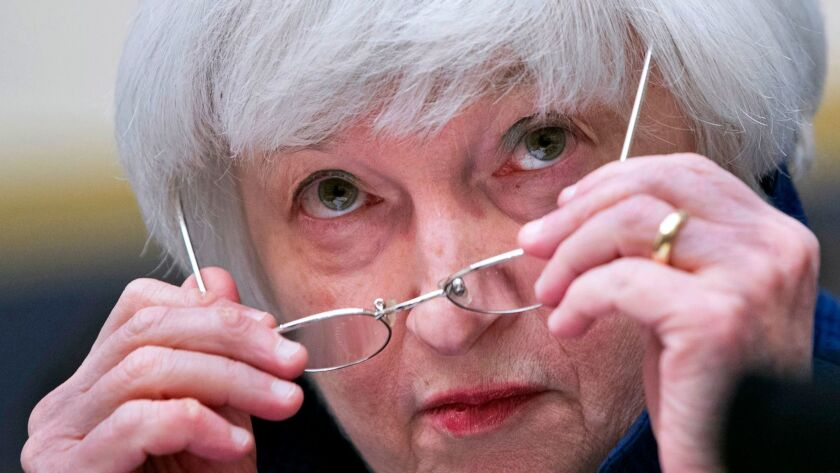 Federal Reserve Chairwoman Janet L. Yellen removes her glasses as she testifies on Capitol Hill in Washington in July.