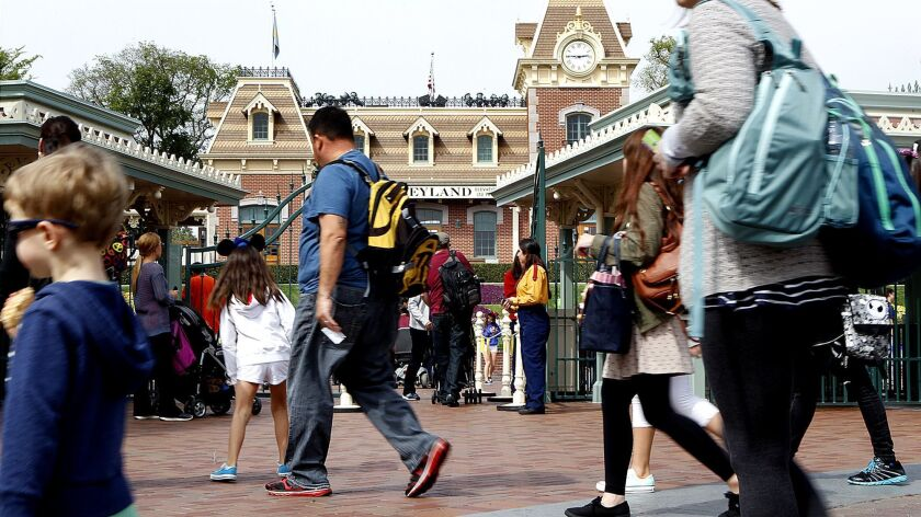 ANAHEIM-CA-MARCH 18, 2013: Visitors pass by the entrance gate to Disneyland on Monday, March 18, 201