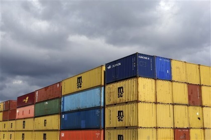 In this March 1, 2013 photo containers sit in stacks after being unloaded from a ship at the Port of Baltimore's Seagirt Marine Terminal in Baltimore.The government reports how much wholesalers adjusted their stockpiles in March on Thursday, May 9, 2013. (AP Photo/Patrick Semansky)