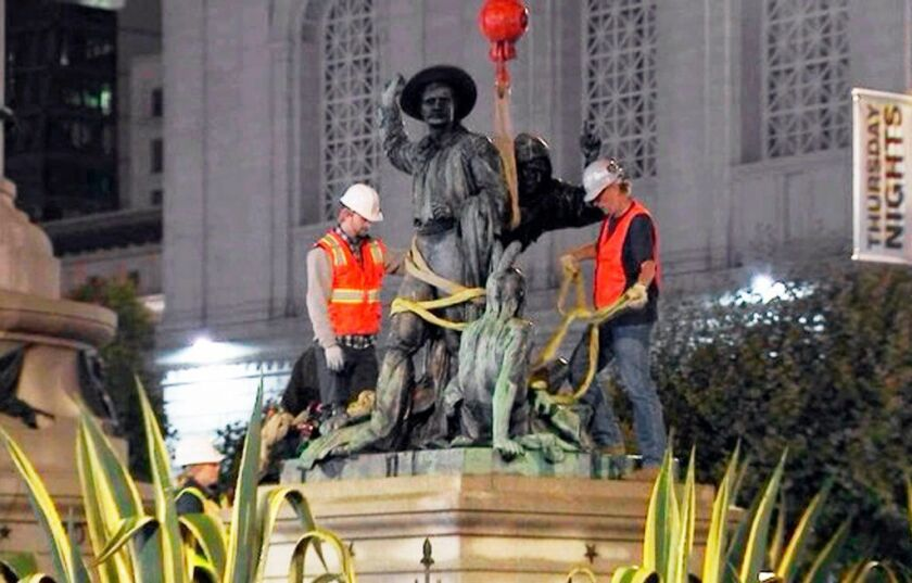 This photo from video provided by KTVU-TV shows crews removing a statue that some have called racist and demeaning to indigenous people, near City Hall in San Francisco early in the morning of Friday, Sept. 14, 2018.