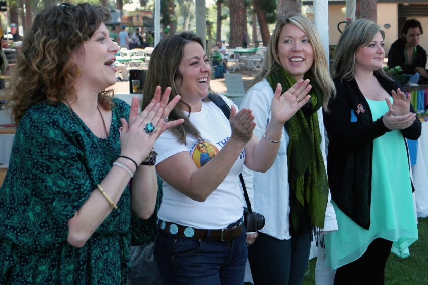 Members of the Rosie Network gather at the organization's Military Entrepreneur Small Business Expo on St. Patrick's Day in Balboa Park. From left to right: Desiree Cantu, owner of Hippie Karma; Jill Ivie, executive director of the Rosie  Network; Deborah Marin, a chiropractor for Discover Wellness