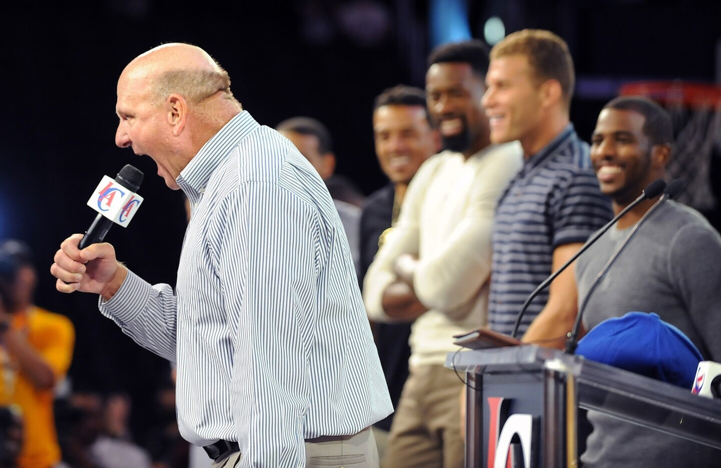 New Clippers owner Steve Ballmer speaks as Clippers players look on during a rally at Staples Center on Monday.