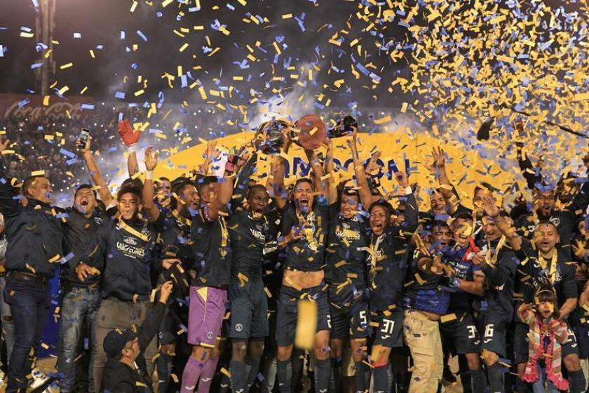 Motagua's players celebrate after defeating Olimpia in the final of the Honduran soccer championship, at the National Stadium, in Tegucigalpa, Honduras, 16 December 2018. EPA-EFE/ Gustavo Amador