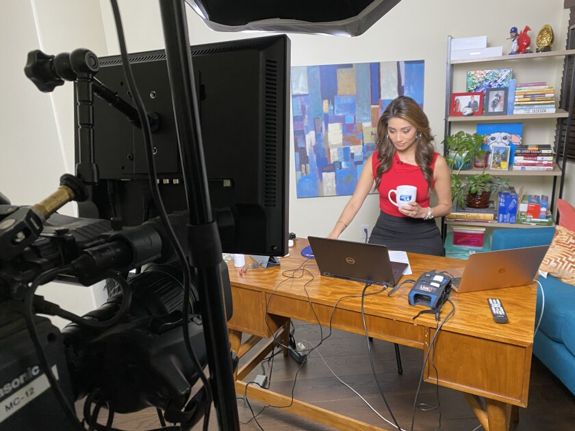 """""""Good Day L.A."""" co-anchor Rita Garcia in the makeshift at-home studio from which she's delivering the news under the city's Safer at Home order."""