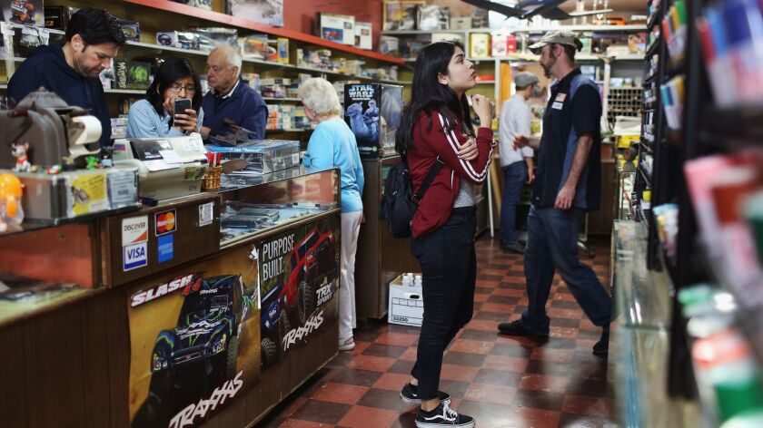 LOS ANGELES, CA-APRIL 22, 2019: Customers peruse the different items at Evetts Model Shop on its las