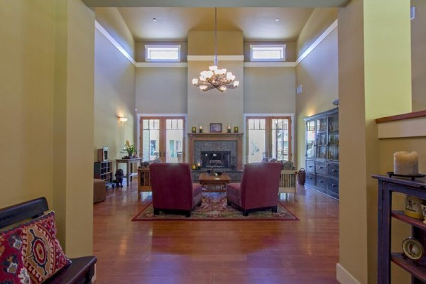 Clerestory windows bring light into the living room, which features 17-foot ceilings, a fireplace and maple floors.