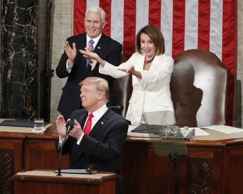 In a brief moment of bipartisanship in 2019, President Trump, Vice President Mike Pence and House Speaker Nancy Pelosi applaud the women who had been newly elected to the House of Representatives.