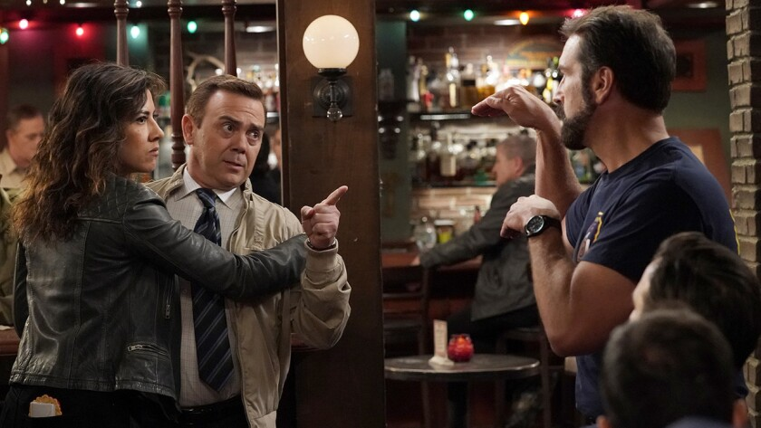 "Stephanie Beatriz, left, Joe Lo Truglio and Rob Riggle in ""Brooklyn Nine Nine"" on NBC."