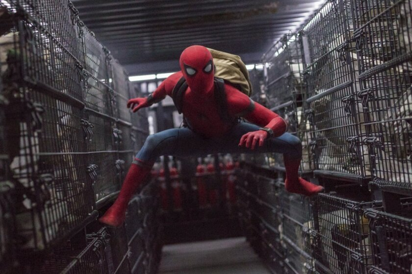"This image released by Columbia Pictures shows Tom Holland in a scene from ""Spider-Man: Homecoming."" Sony Pictures Entertainment and The Walt Disney Studios said Friday that they would be teaming up once more to produce a third film in the ""Spider-Man"" series starring Holland. (Chuck Zlotnick/Columbia Pictures-Sony via AP)"