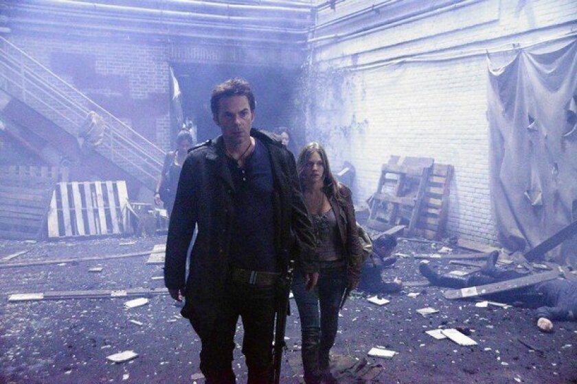 """Billy Burke as Miles Matheson and Tracy Spiridakos as Charlie Matheson in """"Revolution."""""""