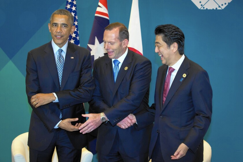 President Obama, from left, and Prime Ministers Tony Abbott of Australia and Shinzo Abe of Japan are among the world leaders gathered in Brisbane for the Group of 20 summit.