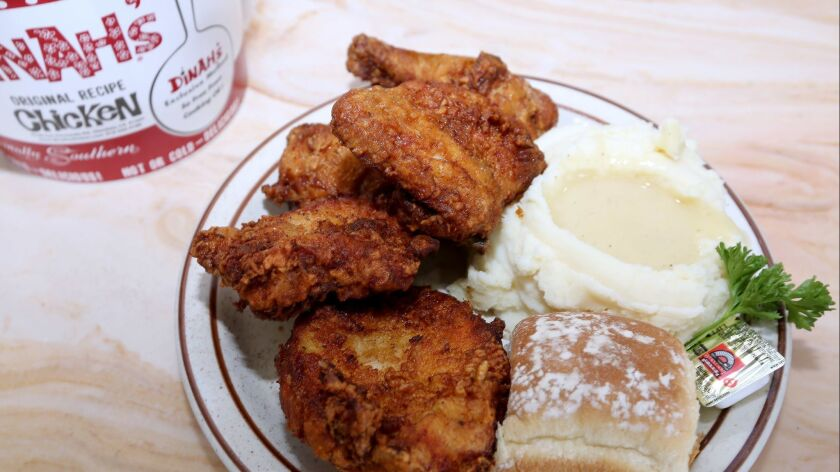 Dinah's patented chicken is fried under pressure, and covered with various herbs and spices to make for a juicy but less oily fried chicken than competitors.
