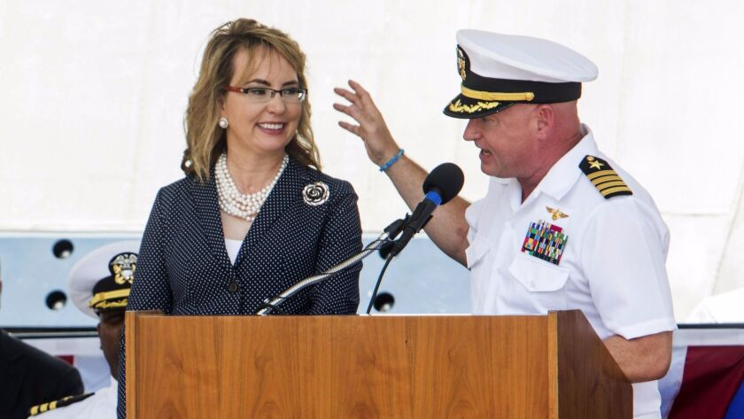 GALVESTON, TX - JUNE 10: Retired Navy Captain Mark Kelly and his wife Gabrielle Giffords share the p