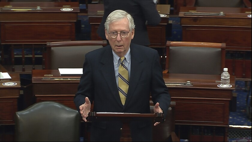 Senate Minority Leader Mitch McConnell speaks at a lectern on the Senate floor.