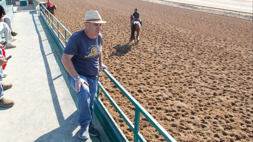 SAN DIEGO, CA December 14th, 2017 | Horse trainer Peter Miller stands along the back stretch at the