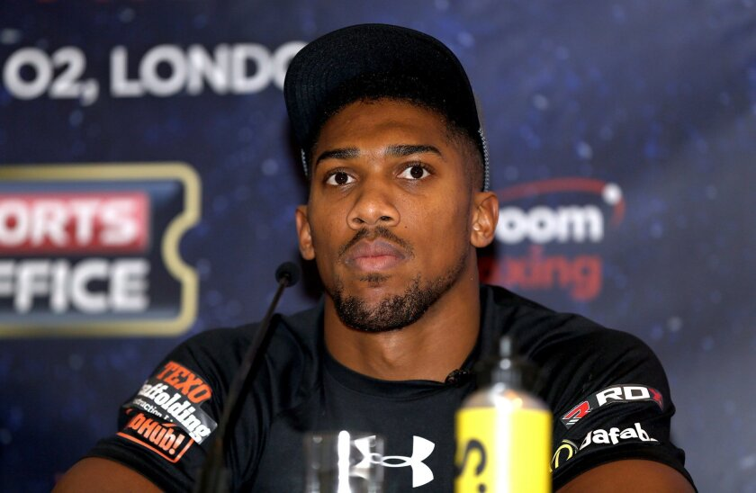 British boxer Anthony Joshua  looks on during the press conference at the Dorchester Hotel, London. Friday Feb. 19, 2016. Joshua  was promoting his heavyweight world title fight against U.S. heavyweight Charles Martin in London on April 9.  (Adam Davy/PA via AP) UNITED KINGDOM OUT