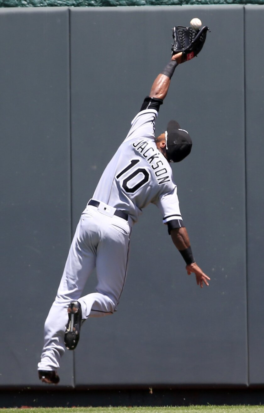 Chicago White Sox center fielder Austin Jackson (10) catches a fly ball hit by Kansas City Royals designated hitter Kendrys Morales during the first inning of a baseball game at Kauffman Stadium in Kansas City, Mo., Sunday, May 29, 2016. (AP Photo/Orlin Wagner)