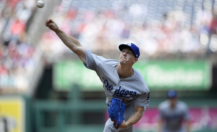 Dodgers starter Walker Buehler delivers during the first inning against the Washington Nationals on Sunday.
